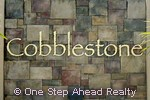 Cobblestone community sign